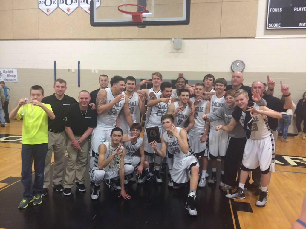 2015 Boys Basketball celebrate their third consecutive regional title in a home win over Century.