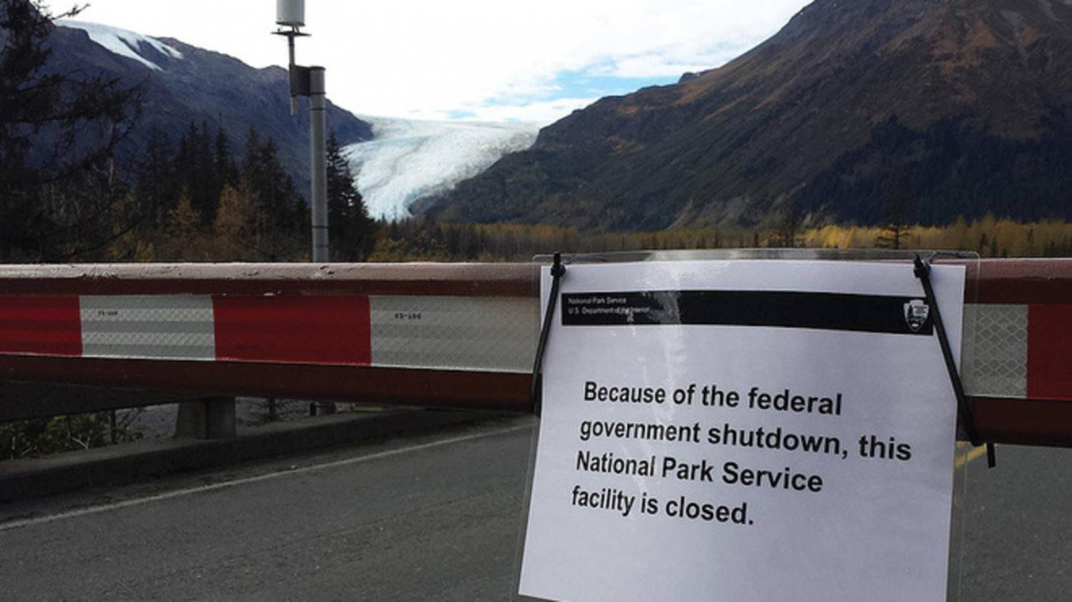 A sign informs tourists that Kenai Fjords National Park in Alaska is closed.