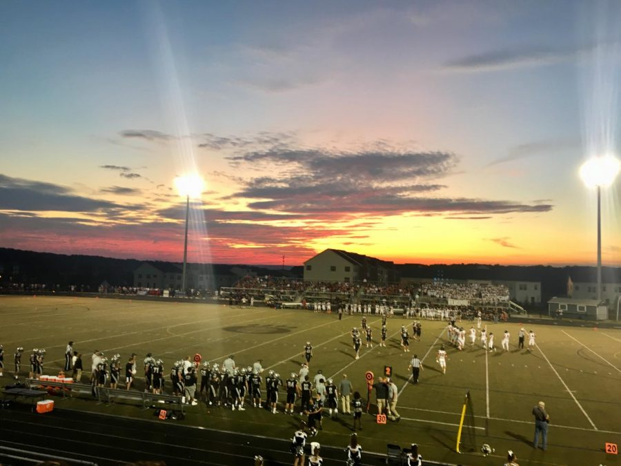 The+Oakdale+and+Linganore+football+teams+warm+up+for+a+hard-fought+game+on+Friday+night.+