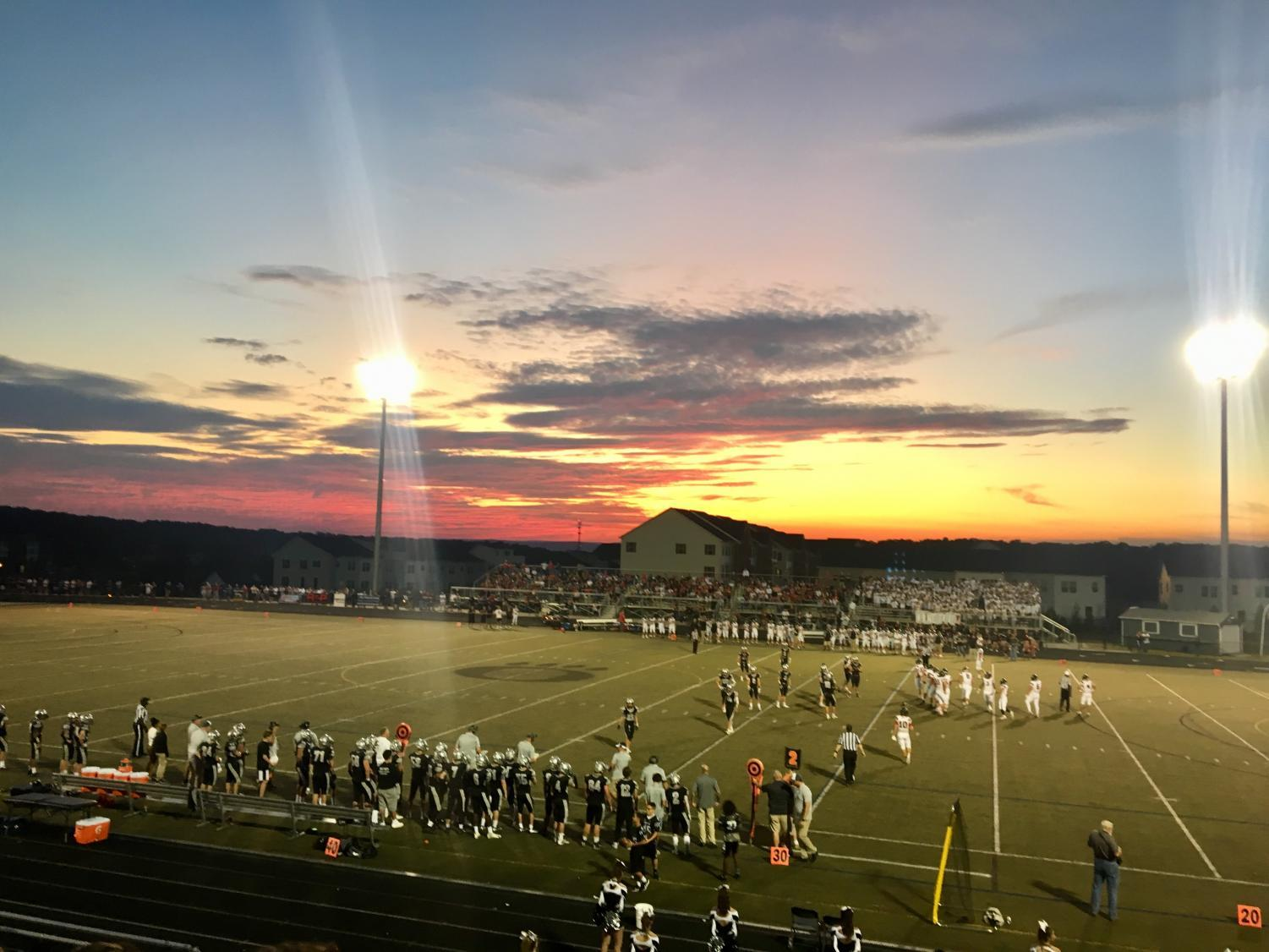 The Oakdale and Linganore football teams warm up for a hard-fought game on Friday night.