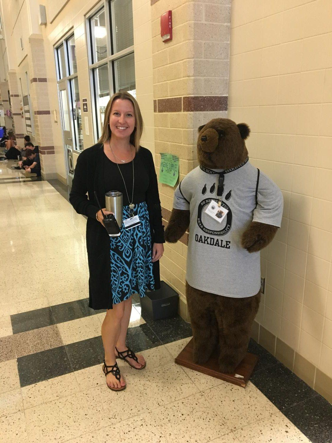 Excited to be a bear, Ms. Smith poses with her new friend Harvey.