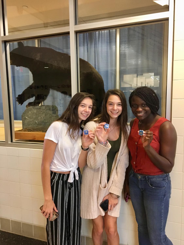 Juniors, Morgan Doolittle, Julia Doolittle, and Tirey Daramola, receive silver stars for their academic achievement.