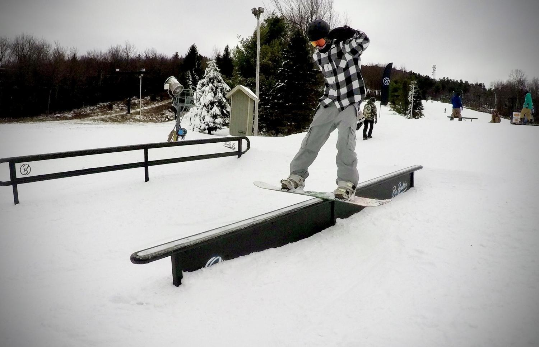 Scotty Boyer doing a boardslide on a rail at Big Boulder, PA.