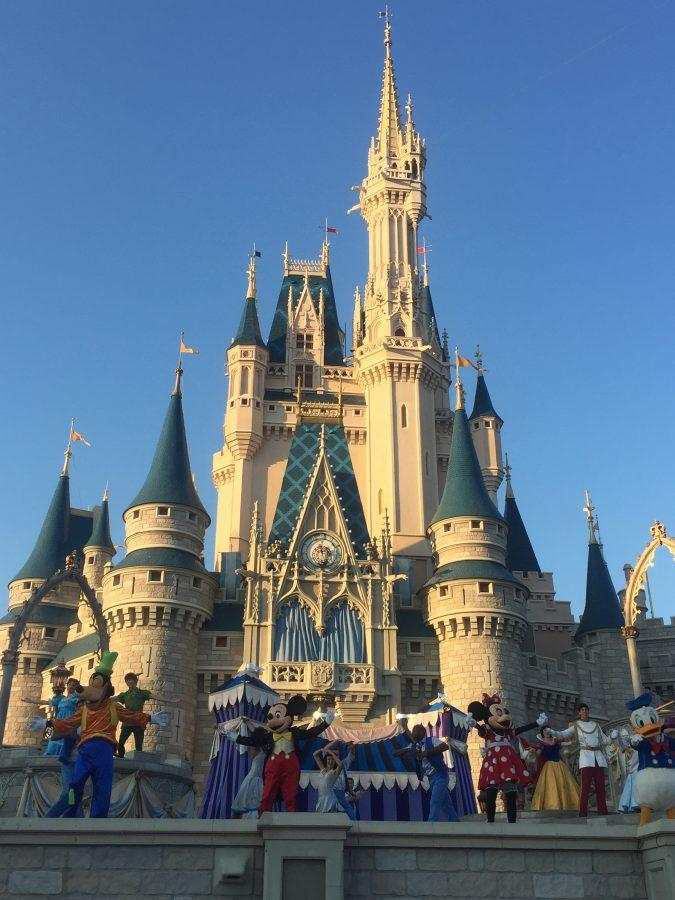 Disney+characters+dance+in+front+of+the+castle.