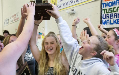 Jacqueline Courtney holds the county title high with other teammates.
