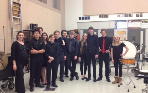 The Jazz band collected in the band room after a great concert.