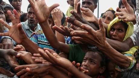 Rohingya muslims grab for aid packages flown over Bangladeshi refugee camps.