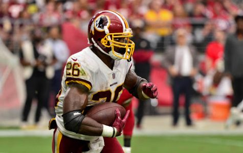 Sep 9, 2018; Glendale, AZ, USA; Washington Redskins running back Adrian Peterson (26) runs the ball during the second half against the Arizona Cardinals at State Farm Stadium. Mandatory Credit: Matt Kartozian-USA TODAY Sports