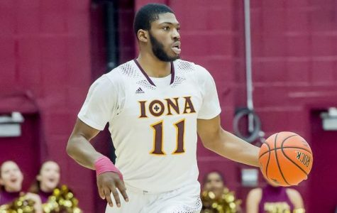 Iona Forward Roland Griffin dribbles the ball up the court.