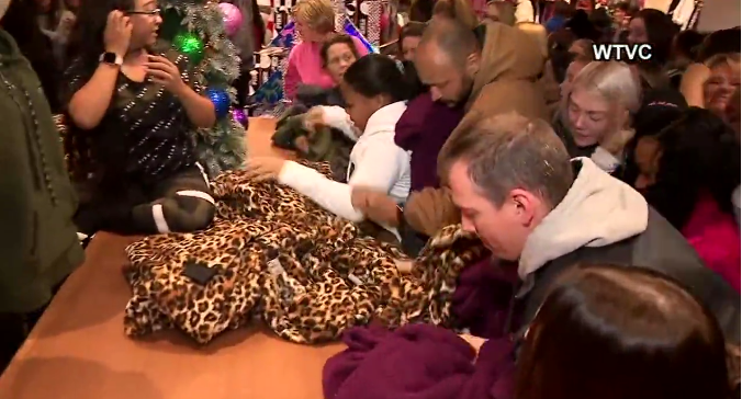 Customers swarm a Victoria Secret in Chattanooga, Tennessee for a fleece hoodie.