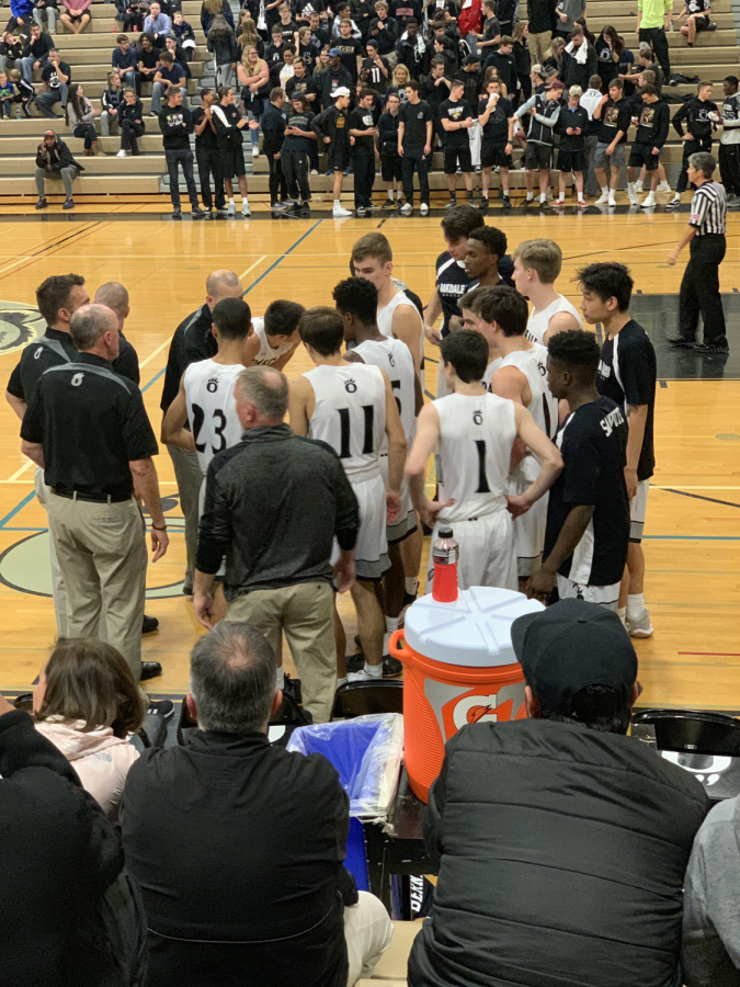 Oakdale basketball plots the defeat of Williamsport during a time out.