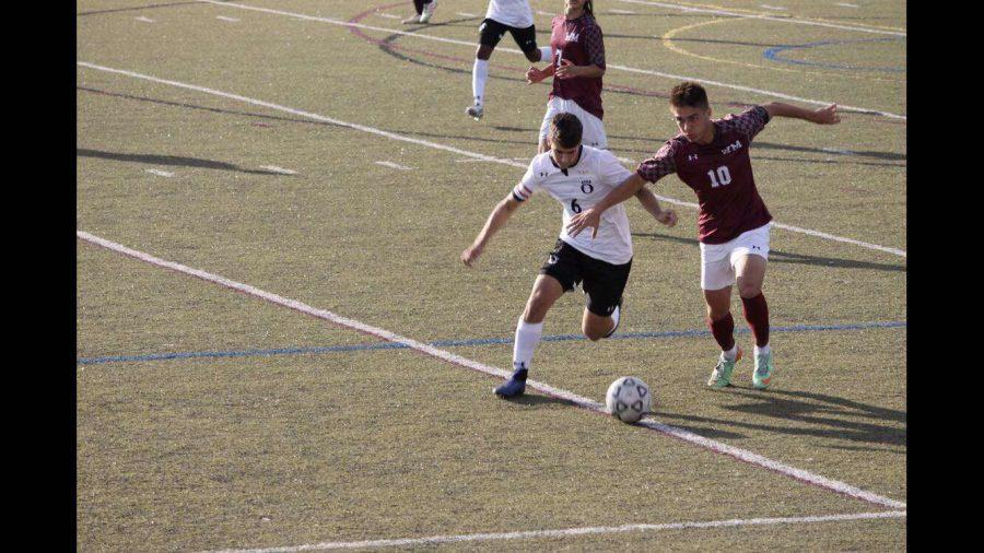 Senior Captain, Daniel Ivanov, wins the ball from the opponent.