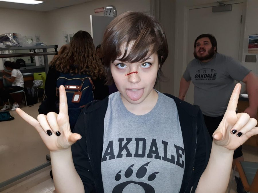 Chloe Hostetter shows off the special effects makeup she learned to do at the event.