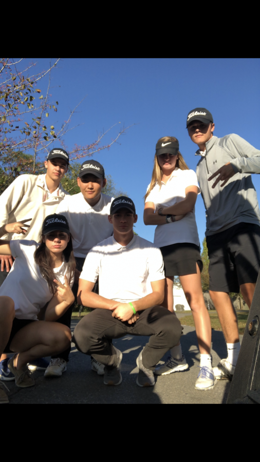 The+golf+team+poses+after+a+victory+against+Linganore.+