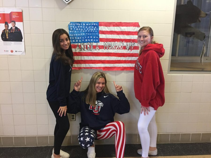 """(Left to right) Juniors Lea Martinez, Gabby Averill and Hayley Winkler dressed up for America Monday, the first day of our Spirit Week! America Monday was actually tied for favorite theme of the week in a survey. When asked about her favorite and least favorite things about spirit week, Junior Lea Martinez explains that she """"enjoys the school spirit leading up to the pep rally by participating in the themed days. I wish more students participated throughout the week. The days were fun, but we should try to  come up with some new themes for next year!"""""""