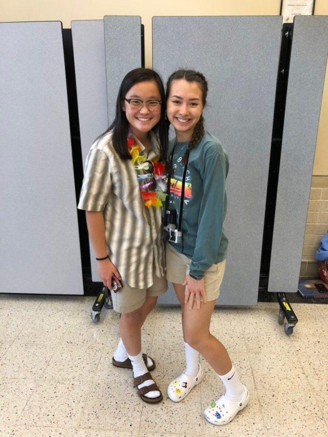 (Left to Right) Seniors Emma Melton and Megan Chang, president of the SGA, participate in Tourist Tuesday. SGA is responsible for choosing and organizing Spirit Week, so Chang played a large role in this.