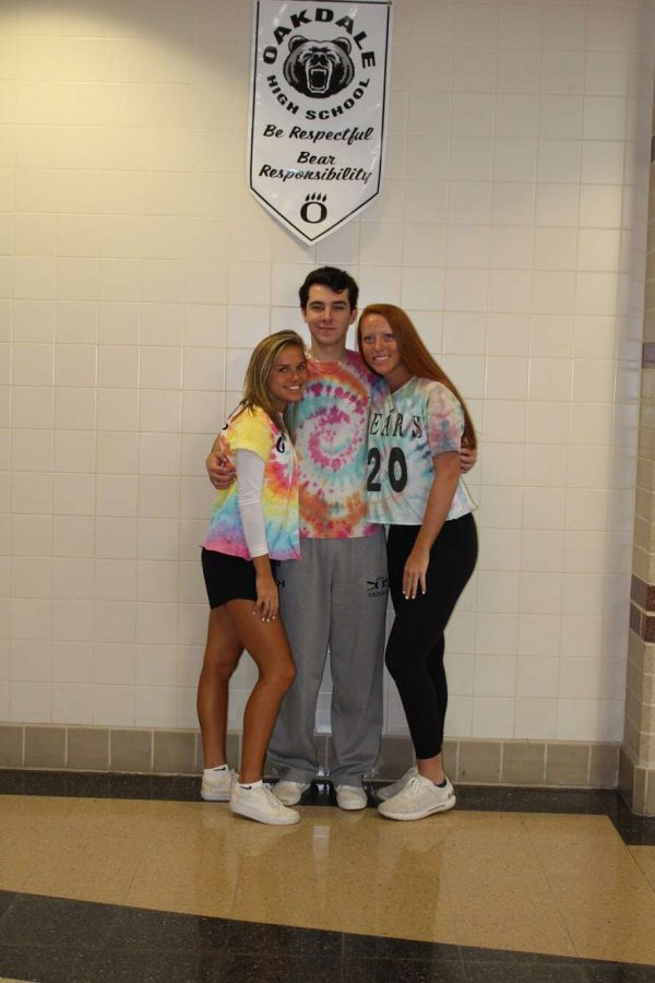 (Left to right)Seniors Alex Dean, Liam McFadden and Taylor Hardesty show off their tye-die for the Seniors. The seniors proved their superiority by winning almost every contest at the pep rally!