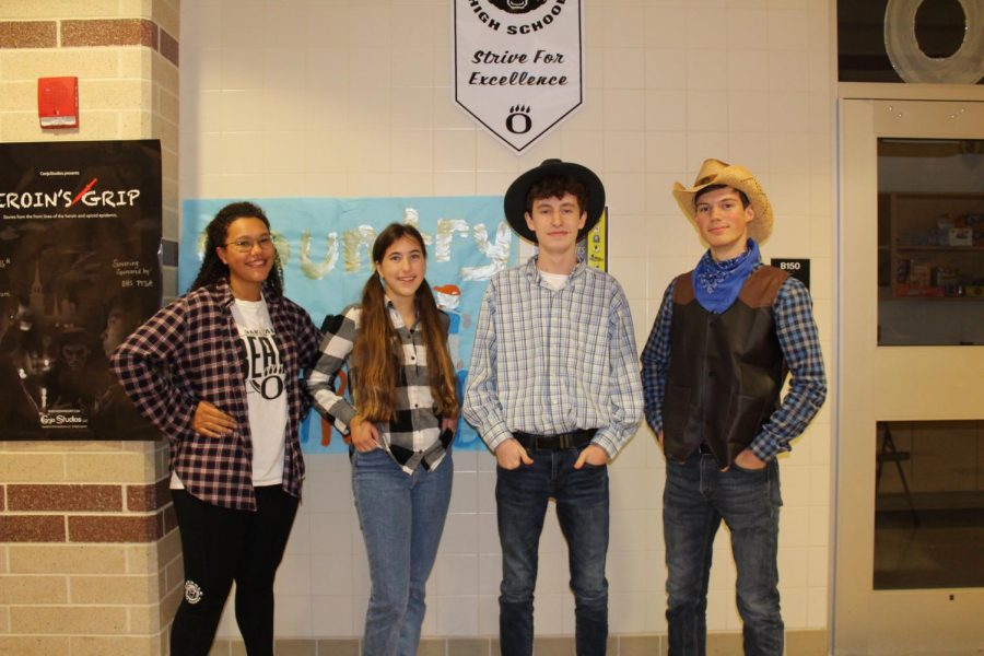 (Left to right) Juniors Exia Baber-Stevens, Sarah Waldych, Hayden Hauptman, and Tyler Campbell show out in country outfits. Overall, most students went to the country side of the day.