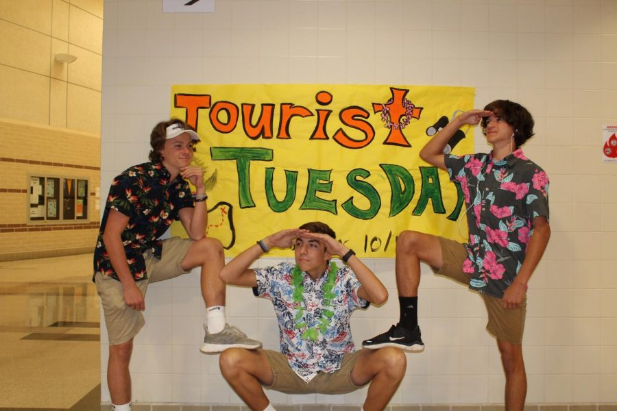 (Left to right) Sophomores Ethan Simpson, Graham Hill, and Leonardo Tannure search the school on tourist day.
