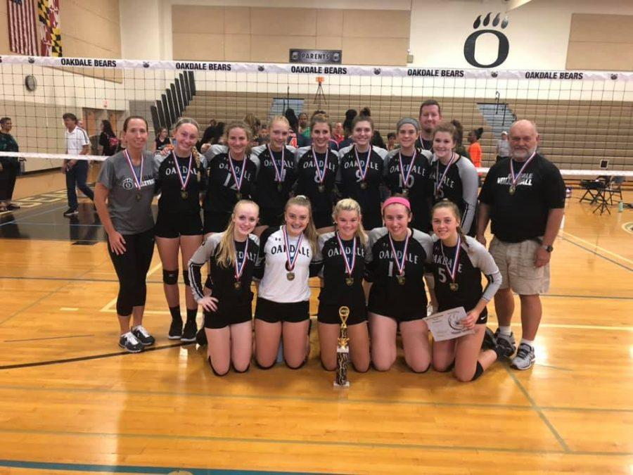The+volleyball+team+with+their+medals+after+winning+first+place+at+the+Varsity+Tournament+hosted+at+Oakdale+on+September+21.