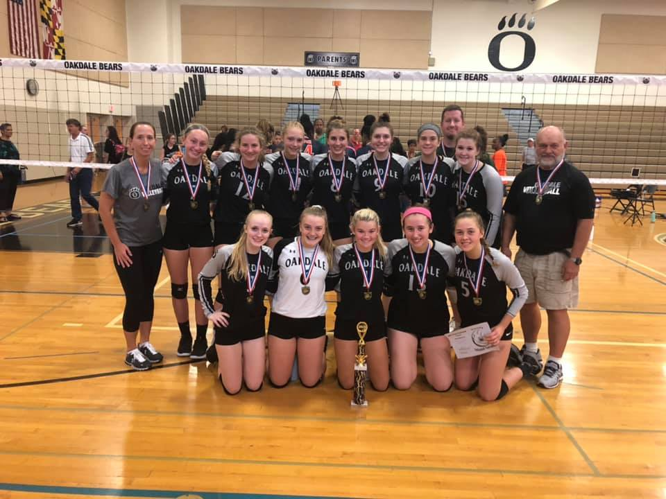 The volleyball team with their medals after winning first place at the Varsity Tournament hosted at Oakdale on September 21.