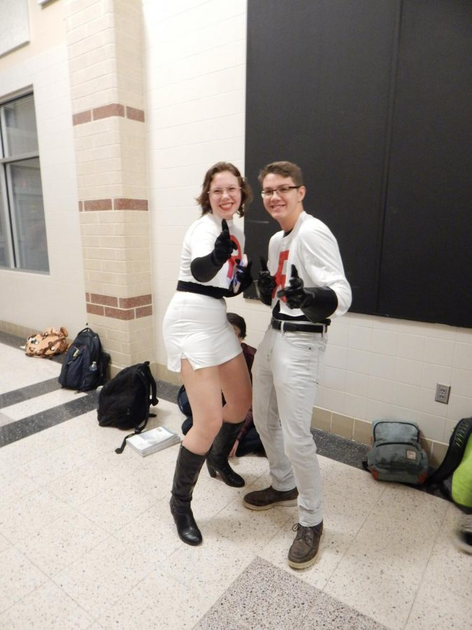 Mandy Shulien and Owen Packen smile brightly before morning classes start in their creative costumes. Both students were very happy to be able to finally dress up for their senior years.