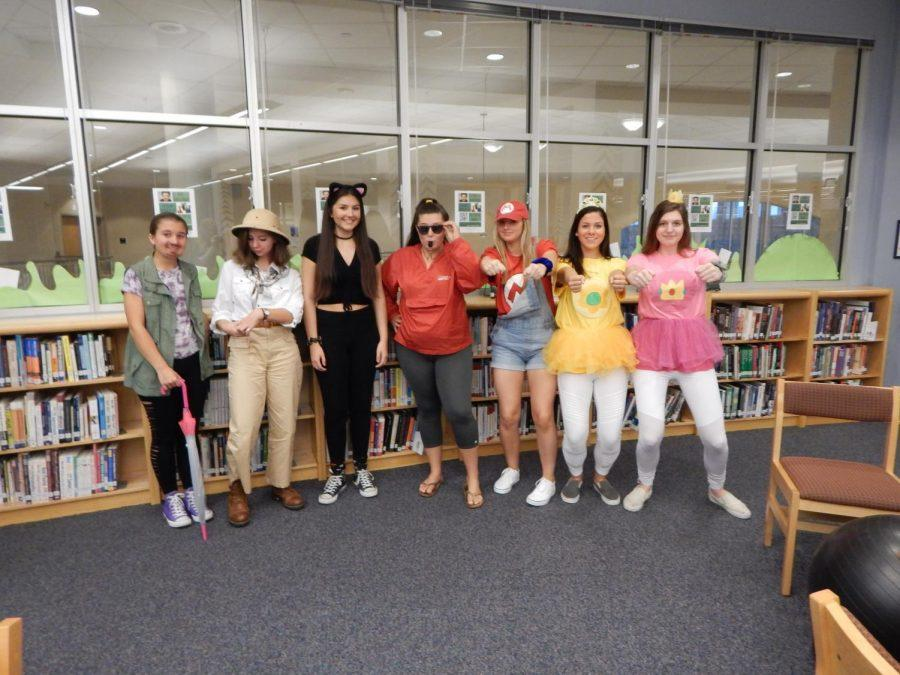 Students in Ms. Smith's first block show off their creativity with their costumes. Each student had a specific pose to match their costumes, such as a lifeguard holding her sunglasses.