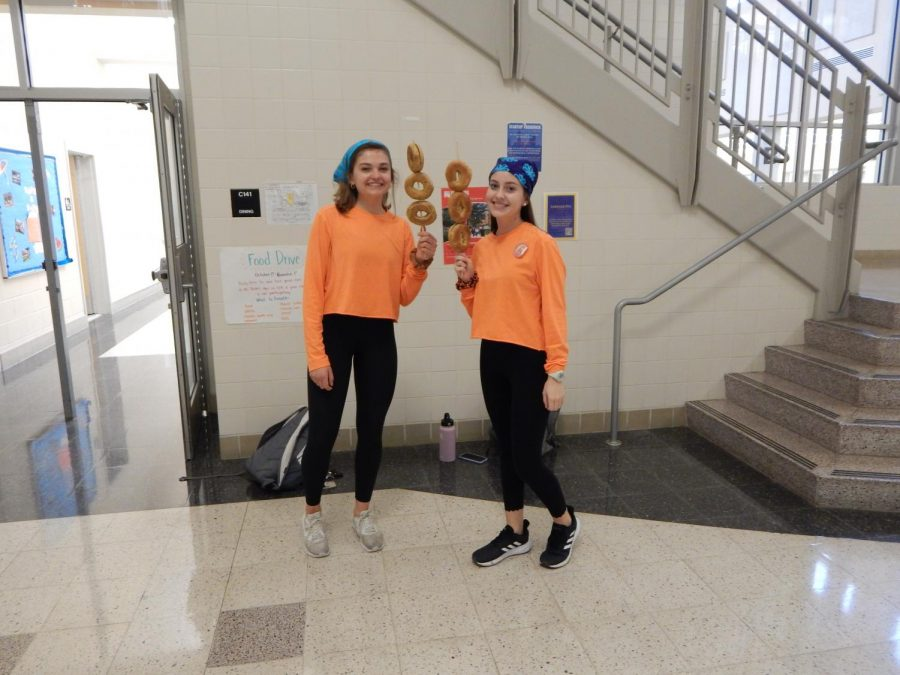 Friends Maddie Miller and Riley Kautz made a reference to iCarly by dressing up as a character from the show, T-bow. They represented the character by wearing a similar uniform to T-bow, wearing bandanas, and holding bagels on a stick.