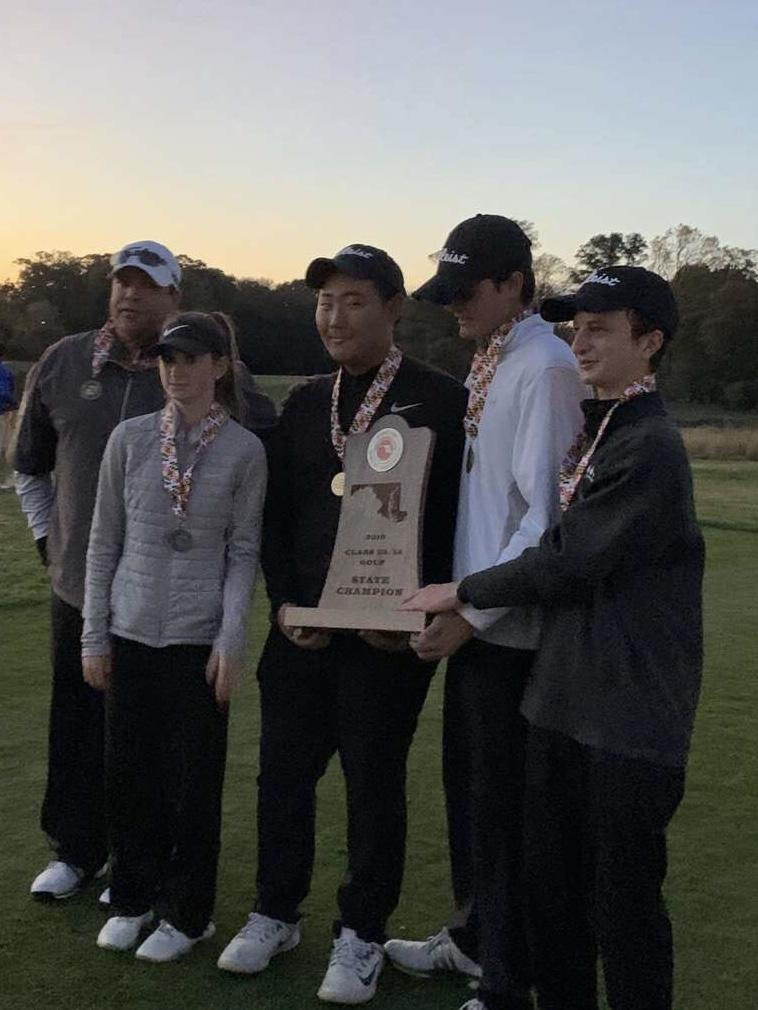 Chris Lee, Elizabeth Tucci, Del Gressier and Micheal Holman hold the state championship after winning.