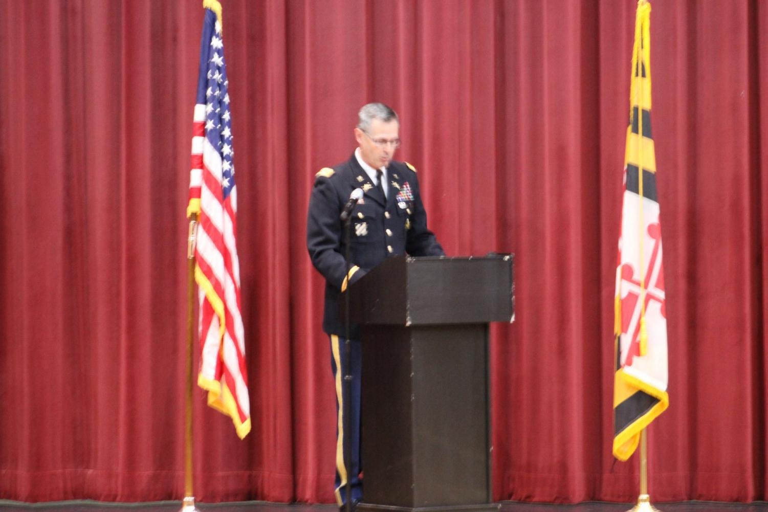 Colonel Wayne Green, Vice President and Chief of Staff at Mount Saint Mary's University stands on the OHS auditorium stage to give speeches thanking OHS faculty staff members who served the military during Thursday's assembly.