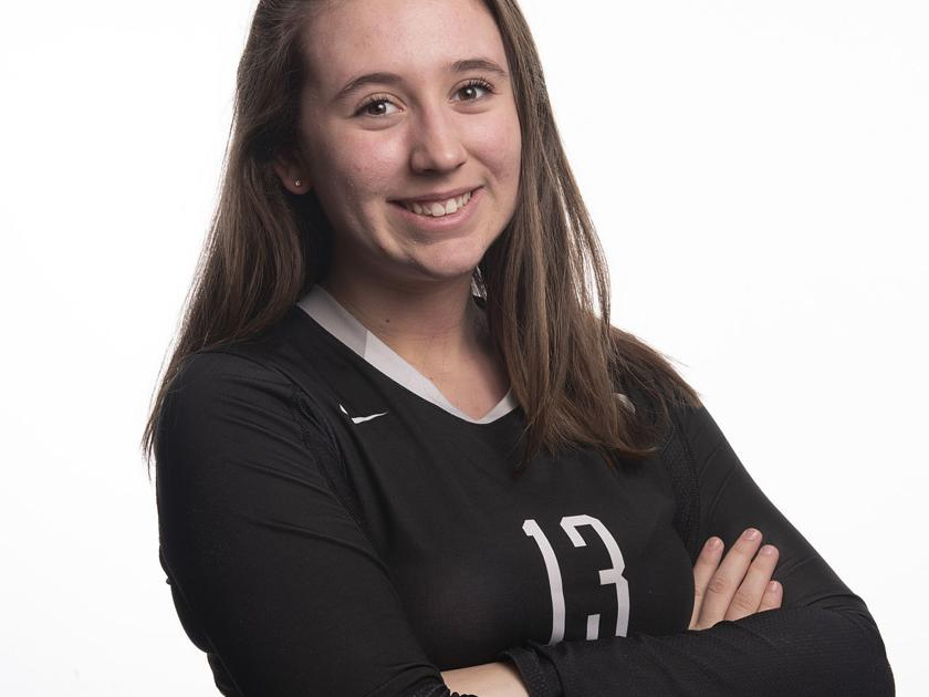 Sydney Katz happily poses for her yearly volleyball photo.