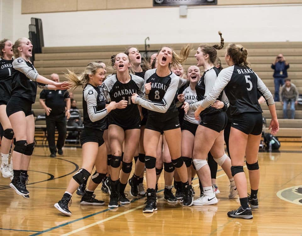 The girls volleyball team wildly celebrating after beating Williamsport for