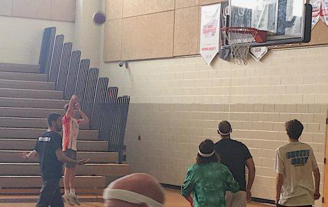 Environmental Club Initiates Green School Plan by Hosting a Student-Teacher Basketball Game