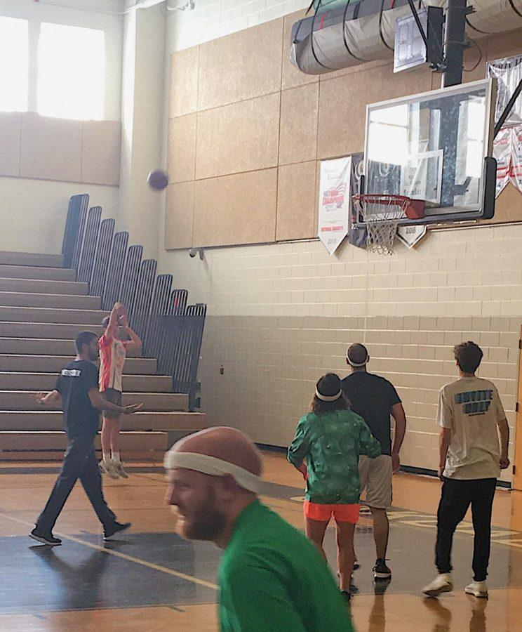 Environmental Club Initiates Green School Plan by Hosting a Student-Teacher Basketball Game