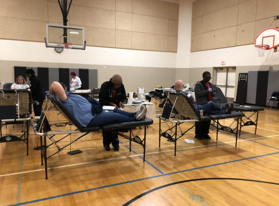 Students and staff donate blood to the blood drive hosted by the National Honor Society.