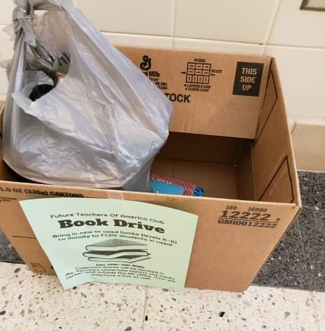 Students can donate books to the boxes with green flyers on them.