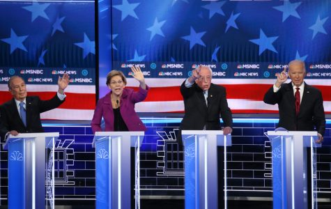 LAS VEGAS, NEVADA - FEBRUARY 19: Democratic presidential candidates (L-R) former New York City Mayor Mike Bloomberg as Sen. Elizabeth Warren (D-MA),  and Sen. Bernie Sanders (I-VT) react as raise their hands during the Democratic presidential primary debate at Paris Las Vegas on February 19, 2020 in Las Vegas, Nevada. Six candidates qualified for the third Democratic presidential primary debate of 2020, which comes just days before the Nevada caucuses on February 22. (Photo by Mario Tama/Getty Images)