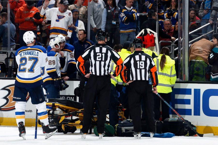 Players+surround+Jay+Boumesster+in+fear+after+he+collapsed+on+the+bench.