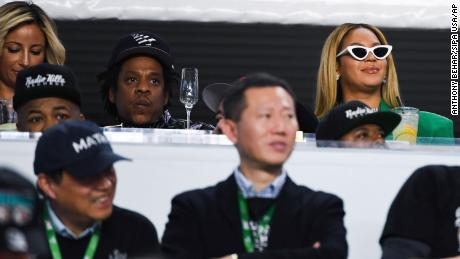 Jay-Z and Beyonce remain seated during the National Anthem at Super Bowl LIV in Miami on Sunday.