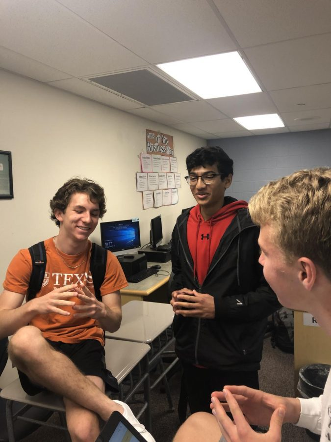 Sophomores Reed Fliegal, Bavan Nadarajah and Sam Starrs discuss putting the final touches on their website.