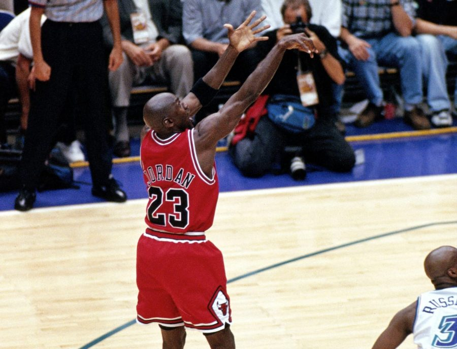 Michael Jordan shoots the final, game winning, shot against the Utah Jazz in the 1998 NBA Finals.