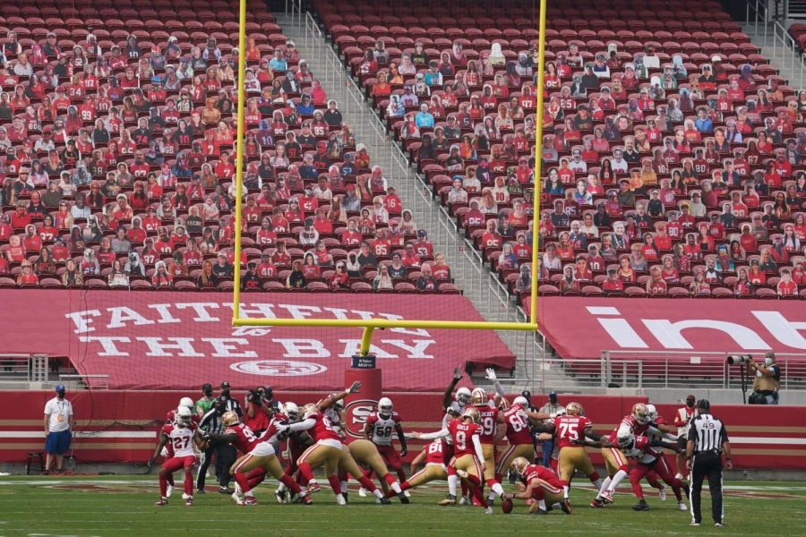The San Francisco 49ers and Arizona Cardinals faceoff with cardboard fans in the stands.