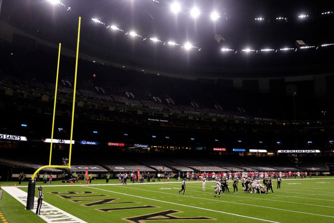 Empty NFL stadium during regular season game in New Orleans due to worldwide pandemic.