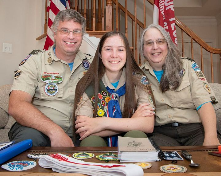 Parents Jim and Susie-Martin Cooper on either side of Ashlyn Cooper one of the first female eagle scouts.