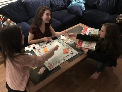 Picture of family playing board games.
