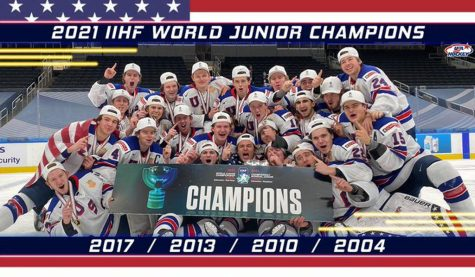 Team USA poses for a picture with their gold medals and world junior championship trophy.