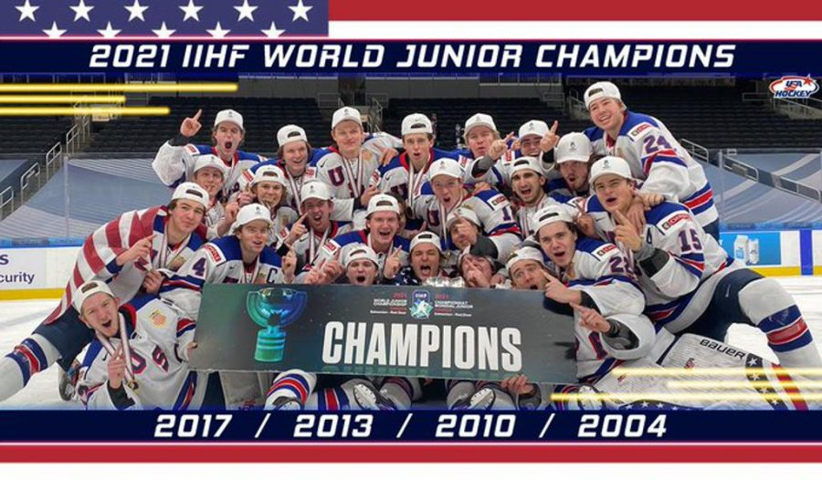 Team+USA+poses+for+a+picture+with+their+gold+medals+and+world+junior+championship+trophy.+