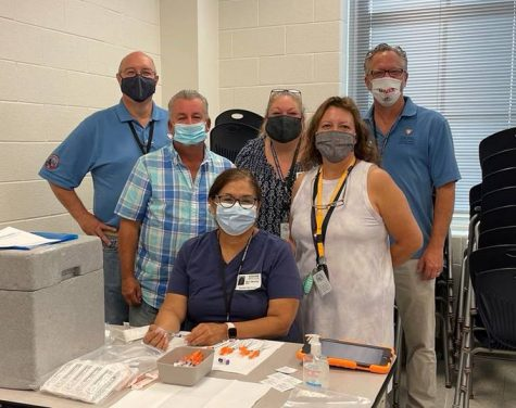 Members of the Frederick County Health Department smile for a photo during the Vaccine Clinic that was held at Oakdale High School on 8/27/21.