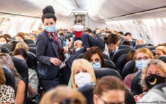 Passengers masked up on a busy flight departing from an airport in the Netherlands, in June 2020.