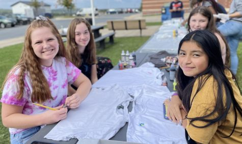 Alaina Etter, in yellow, and her friends decorating T-shirts at the Oakdale T-shirt decorating party.